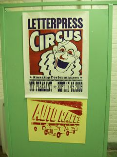 partial posters in the men's bathroom, hamilaton wood type museum